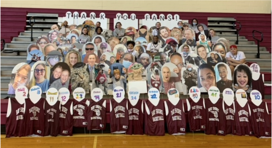 Cardboard cutouts of family and friends of student athletes fill the stands in the gymnasium. The cutouts are part of the Fill the Stands program which works to give athletes virtual fans to play for during the pandemic. The number of spectators has been limited since sports returned in March.